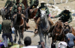 U.S. border agents on horses with whips, storming through a group of Haitian people