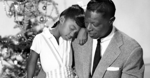 "the musical life and career of nat king cole Born on this day, nat king cole possessed a unique soft baritone voice which, to use the title of one of his most famous songs, was ""unforgettable"" but despite his talent and huge success as a recording artist his short life was plagued by incidents of racial discrimination at the age of four ."