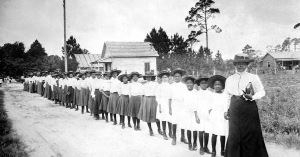 Mary McLeod Bethune with girls from the Literary and Industrial Training School for Negro Girls in Daytona, circa 1905.