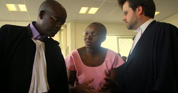 Victoire Ingabire with lawyers Gatera Gashabana and Iain Edwards in 2012.