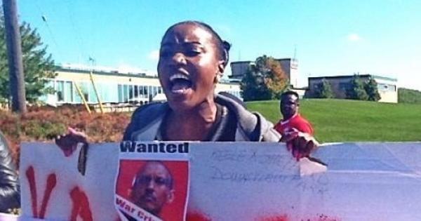 Angry protestor outside Rwandan President Paul Kagame's appearance in Toronto.
