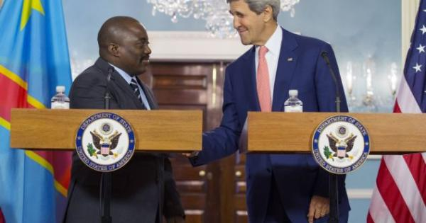Legitimacy: A friendly Secretary of State John Kerry (R) appeared Monday August 4, 2014 alongside Congolese president Joseph Kabila (L) before a bilateral meeting during the U.S.-Africa Leaders Summit in Washington, without a mention of Kabila's human rights problems at home. &copy AP