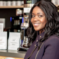 Margaret Nyamumbo has made history as the first Black entrepreneur to have her coffee brand, Kahawa 1893, sold in Trader Joe's
