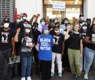 """""""Whose streets?"""" Omowale Clay shouted. """"Our streets!"""" came the response."""