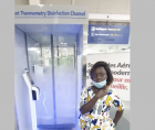 Woman at airport sanitizer booth in Benin