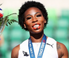 hammer thrower Gwen Berry, a Black American, protested on the podium at the U.S. track and field Olympic Trials on Saturday.