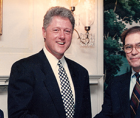 """Journalist James Haught (shown here with Bill and Hillary Clinton in 1994) says """"actually, it's a crime to trust god"""""""