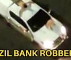 Bank robbers armed with explosives and high-powered rifles have plunged a Brazilian city into terror early Monday