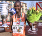 The 19-year-old won Uganda's first ever medal in his debut at the event, clocking a championship record of 58:49.