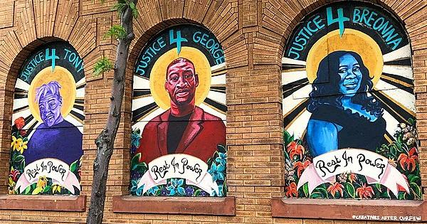 A mural depicting George Floyd, Tony McDade, and Breonna Taylor created by artist Leslie Barlow in Minneapolis, Minnesota.