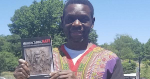 """Black Star News publisher Milton Allimadi with his new book """"Manufacturing Hate: How Africa Was Demonized in Western Media."""""""