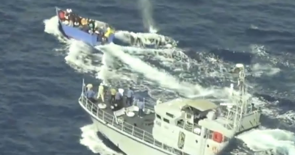 video showing a Libyan coast guard vessel firing at and chasing a boat in distress that was carrying migrants