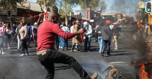 South Africa was gripped by a frenzy of looting and arson - the worst scenes of violence since the advent of democracy in 1994