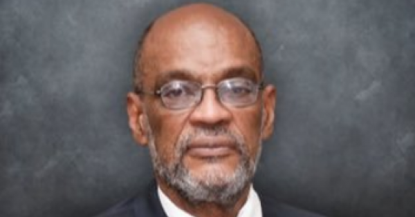 prosecutor asked a judge to charge Haiti's prime minister (above) in connection with the crime.