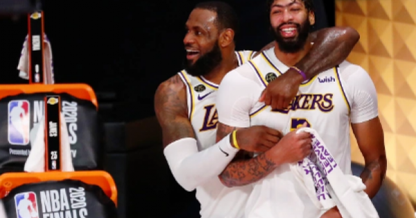 LeBron James and Anthony Davis celebrate championship win against James' old Miami Heat team.