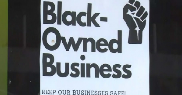 Black business owners gathered on a commercial strip in Chatham Monday morning to urge their colleagues and customers to cast ba
