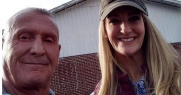The photo shows Loeffler posing next to Chester Doles, a former Ku Klux Klan leader and member of the neo-Nazi National Alliance