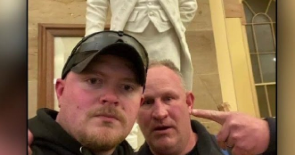 two Rocky Mount Virginia police officers (who have been charged) are seen inside the Capitol building Wednesday during the riot.