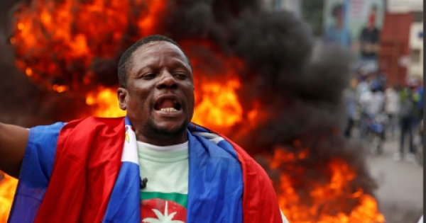 Haitian police on Wednesday clashed with rock-hurling protesters in the capital Port-Au-Prince amid street demonstrations agains