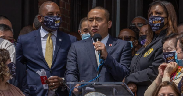 Queens College President Frank H. Wu (above) speaks at an anti-hate rally