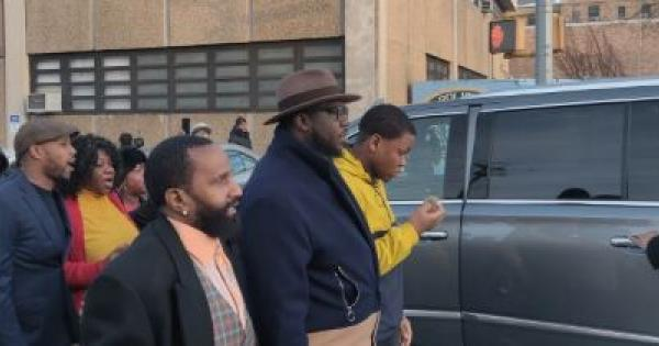 Fitzroy Gayle (far right) is seen with community activist Rev. Kevin McCall (center) at a rally in Brooklyn on Thursday after he was attacked by NYPD cops.